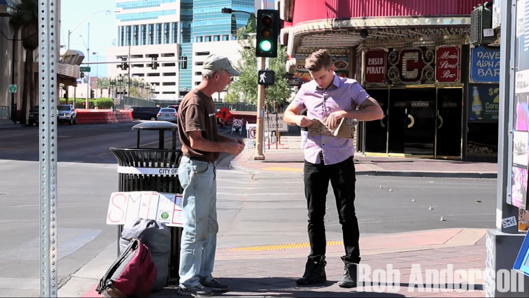 Anderson and homeless man